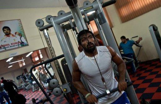 Indian wrestler and London Olympics bronze-medal winner Yogeshwar Dutt works out on March 5, 2013