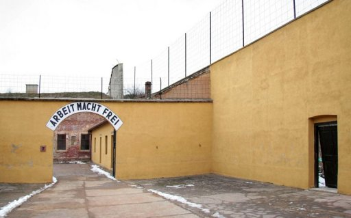 This file photo shows the entrance to the fortress in the Czech city of Terezin with the Nazi phrase: