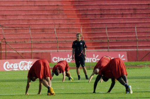 US football team coach Jurgen Klinsmann, looks at his players during a training session in Honduras, February 5, 2013