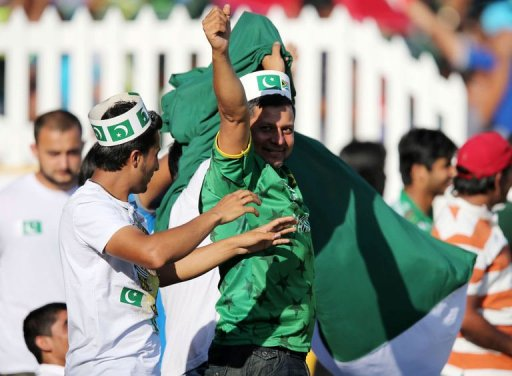 Pakistan fans celebrate at Sahara Stadium Kingsmead on March 21, 2013 in Durban