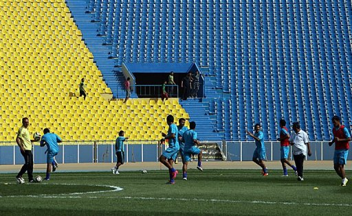 Iraqi footballers train at Baghdad's Al-Shaab Stadium on April 15, 2011