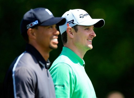 Tiger Woods (L) and Justin Rose on March 21, 2013, in Orlando