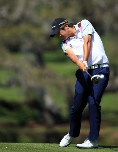 John Huh plays his tee shot at the par 5, 16th hole, in Orlando, on March 21, 2013