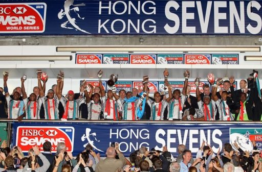 Last year's winners, Fiji, celebrate on the winners podium after beating N.Zealand, in Hong Kong, on March 25, 2012