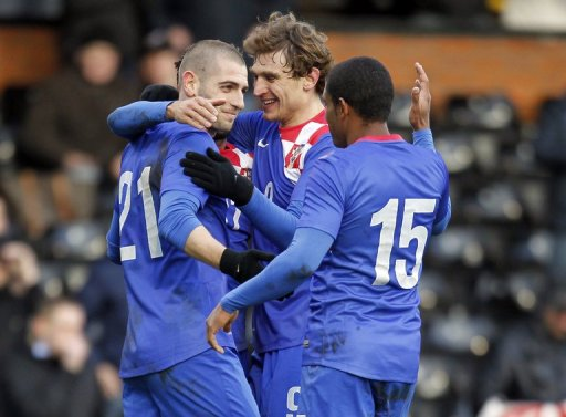 Croatian players celebrate scoring a goal during match against South Korea in London on February 6, 2013