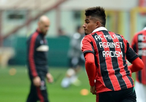 AC Milan's Ghanaian defender Prince Kevin Boateng warms upbefore the match against Siena on January 6 , 2013, in Milan