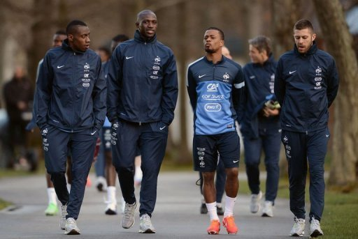 Members of the French national football team arrive for a training session near Paris, on March 18, 2013