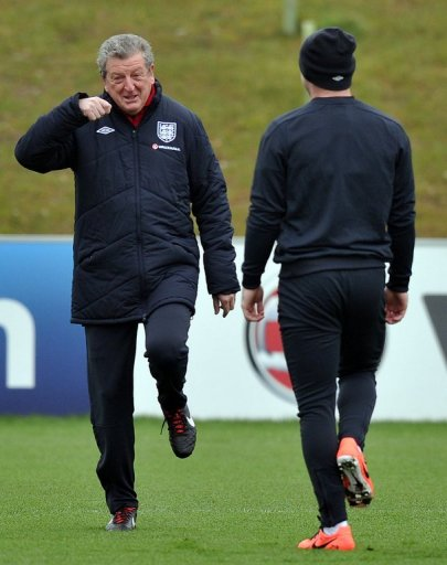 England manager Roy Hodgson (L) and striker Wayne Rooney (R) attend  training in Burton-upon-Trent, March 19, 2013