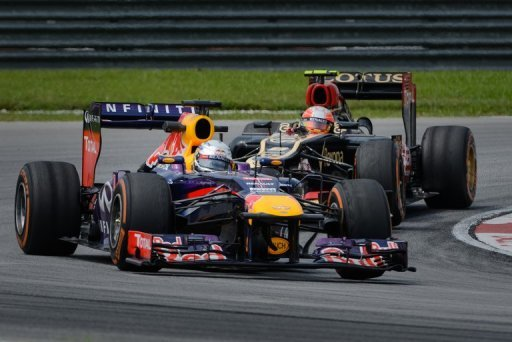 Sebastian Vettel (front) and Romain Grosjean drive in Sepang on March 22, 2013 in practice for the Malaysian Grand Prix