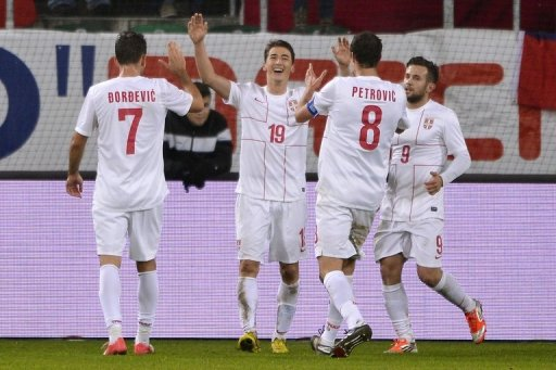 Filip Duricic (centre) celebrates Serbia's third goal against Chile in St Gallen on November 14, 2012
