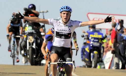 Irish Daniel Martin of the Garmin-Cervelo team celebrates as he crosses the finish line on August 28, 2011