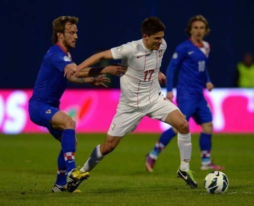 Croatia's midfielder Ivan Rakitic (L) tries to tackle Serbia's Alaksandar Ignjovski, March 22, 2013