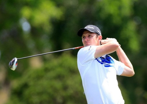 Justin Rose of England plays a shot at the Arnold Palmer Invitational on March 22, 2013 in Orlando, Florida
