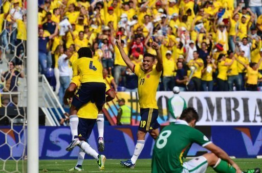 Colombia's players celebrate after scoring against Bolivia, in Barranquilla, on March 22, 2013