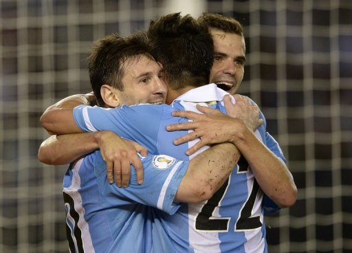Argentina's players celebrate after scoring a penalty against Venezuela, in Buenos Aires, on March 22, 2013