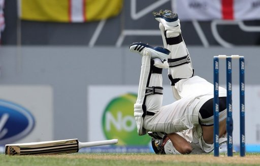 New Zealand's Tim Southee rolls over after making a run, at Eden Park in Auckland, on March 23, 2013