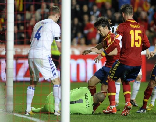Spain's David Silva is blocked by Finland goalkeeper Niki Maenpaa in their FIFA 2014 World Cup qualifier March 22, 2013
