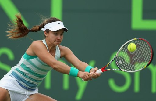 Lauren Davis plays a backhand to Madison Keys at Crandon Park Tennis Center on March 22, 2013