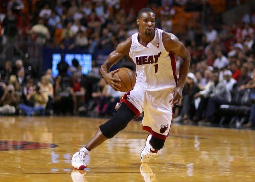 Chris Bosh of the Miami Heat drives during a game against the Detroit Pistons at American Airlines Arena March 22, 2013