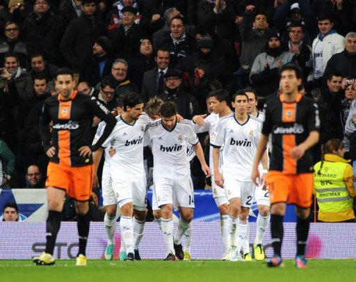 Real Madrid's players celebrate during the Copa del Rey at the Santiago Bernabeu Stadium, Madrid, January 15, 2013