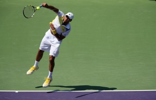 Jo-Wilfried Tsonga of France serves against ViktorTroicki of Serbia on March 23, 2013 in Key Biscayne, Florida