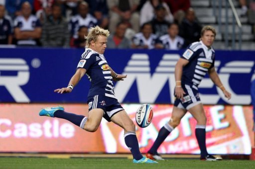 Stormers' Joe Pietersen (L) clears the ball during a Super 15 Rugby match on March 16, 2012