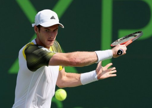 Andy Murray of Scotland plays a backhand against Bernard Tomic of Australia, March 23, 2013 in Key Biscayne, Florida