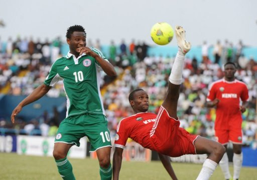 Nigeria's John Mikel Obi (L) goes for the ball against Kenya's Mulinge Ndeto, March 23, 2013 in Calabar