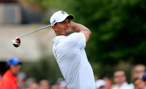 Tiger Wodds of the United States plays his tee shot at the 1st hole at Bay Hill Golf and Country Club on March 23, 2013