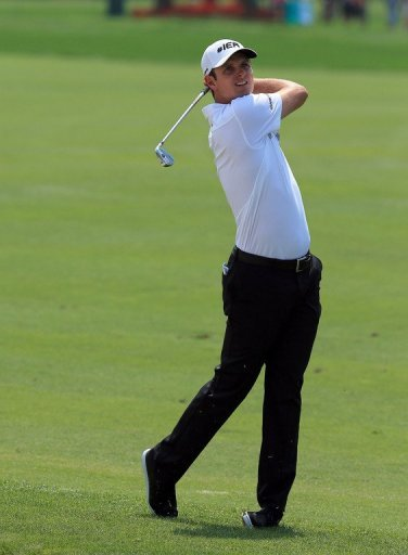 Justin Rose of England plays his second shot on the 1st hole at Bay Hill Golf and Country Club on March 23, 2013