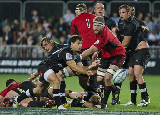 Southern Kings' Nicolas Vergallo  (front L) clears the ball against the Canterbury Crusaders, on March 23, 2013