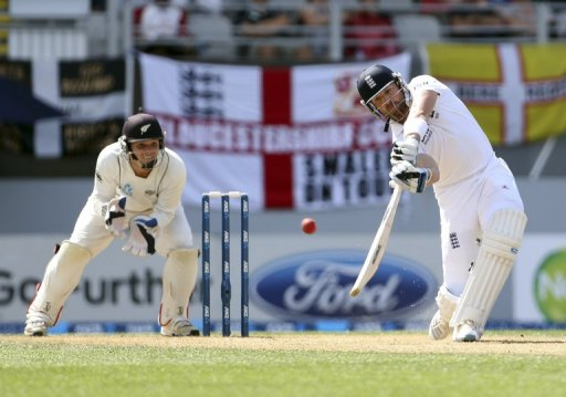 England's Matt Prior (R) bats, watched by New Zealand's BJ Watling, in Auckland, on March 24, 2013