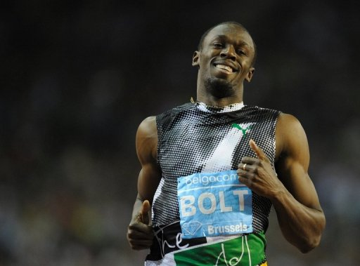 Jamaica's Usain Bolt celebrates after winning the men's 100m at the Diamond League athletics meeting, September 7, 2012