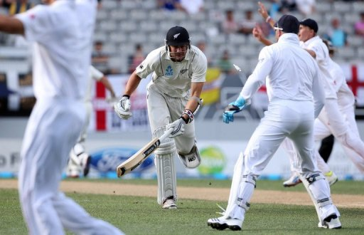 New Zealand's Peter Fulton (C) makes his ground for a single run, in Auckland, on March 24, 2013