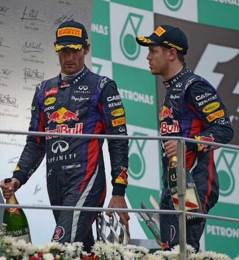 Red Bull driver Sebastian Vettel of Germany (right) and teammate Mark Webber of Australia in Sepang on March 24, 2013
