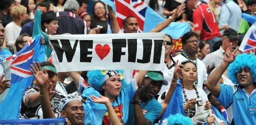 Fijian fans cheer as their team plays against New Zealand during the Hong Kong Rugby Sevens tournament on March 24, 201