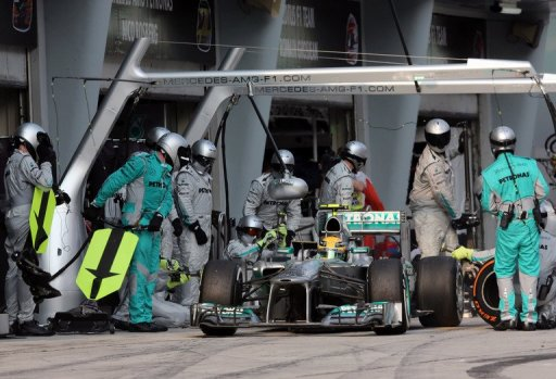Mercedes driver Lewis Hamilton leaves after a pitstop during the Formula One Malaysian Grand Prix ,Sepang,March 24, 2013