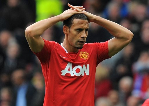 Manchester United defender Rio Ferdinand reacts at Old Trafford in Manchester, north-west England on April 22, 2012