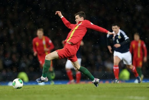 Gareth Bale of Wales sin a World Cup qualifier at Hampden Stadium, Glasgow, Scotland, on March 22, 2013