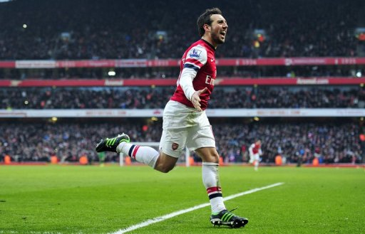 Arsenal's Santi Cazorla celebrates scoring at the Emirates Stadium in London on February 23, 2013