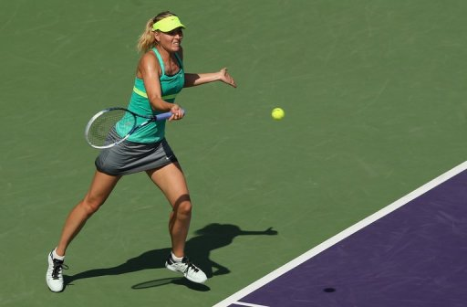 Maria Sharapova plays a forehand against Elena Vesnina on March 24, 2013 in Key Biscayne, Florida
