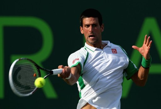 Novak Djokovic of Serbia plays a forehand on March 24, 2013 in Key Biscayne