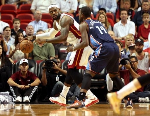 Miami's LeBron James (L) and Charlotte Bobcats' Michael Kidd-Gilchrist is pictured during their game on March 24, 2013