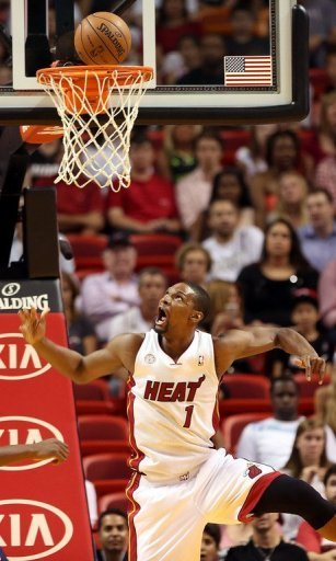 Miami Heat forward Chris Bosh shoots during their game against the Charlotte Bobcats on March 24, 2013