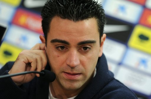 Spain midfielder Xavi Hernandez answers questions during a press conference in Barcelona, on February 21, 2013
