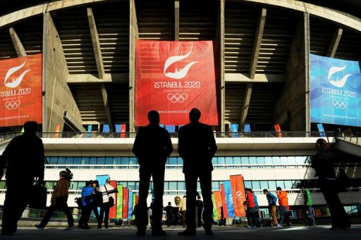 Members of the media enter the Ataturk Olympic Stadium on March 24, 2013 in Istanbul