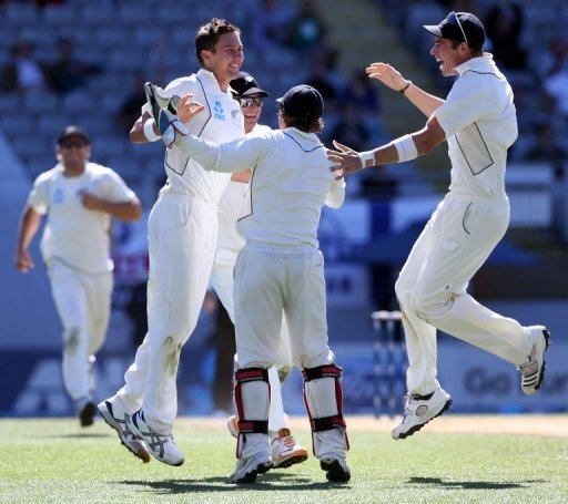 Trent Boult (second L) celebrates the wicket of Joe Root at Eden Park on March 26, 2013