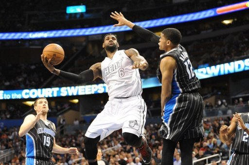 LeBron James shoots over Tobias Harris on March 25, 2013