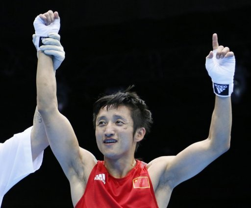 Zou Shiming is declared the victor after defeating Paddy Barnes at the London Olympics on August 10, 2012