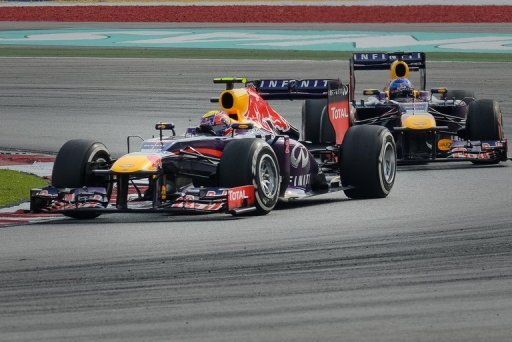 Red Bull driver Mark Webber leads his team-mate Sebastian Vettel at the Malaysia Grand Prix in Sepang on March 24, 2013